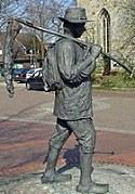Standbeeld van een hannekemaaier in Uelsen (D.)