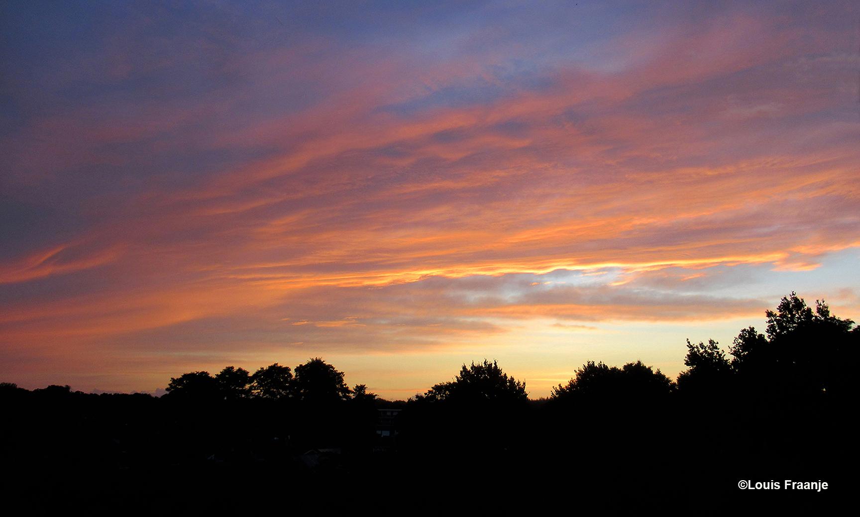 Zo'n hemel vol met kleuren, blijft een prachtig schouwspel - Foto: ©Louis Fraanje